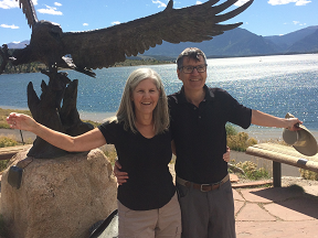 photo of Pete and Nancy under a statue of a soaring eagle at Lake Dillon